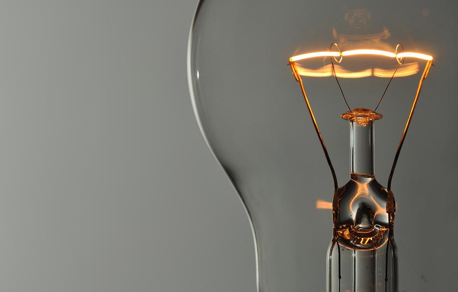Macro photo of glowing lightbulb filament